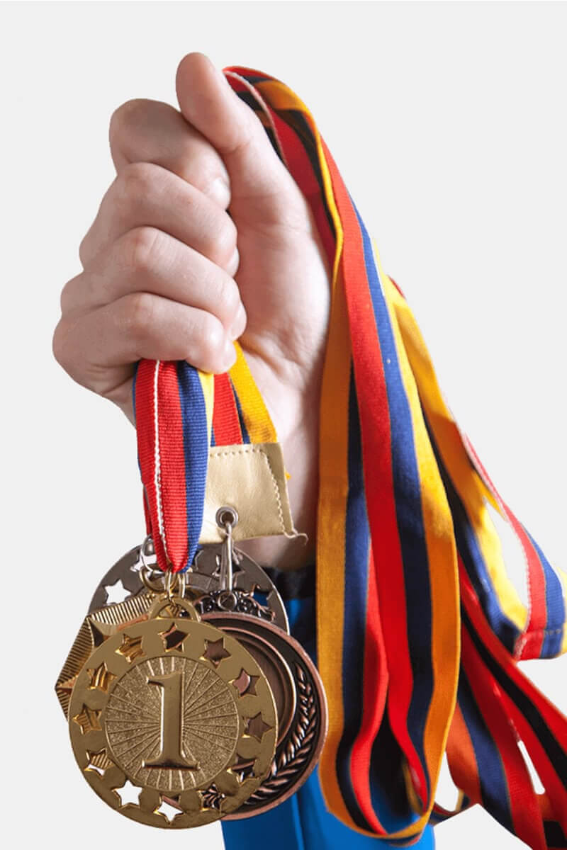 Picture of a child holding math medals