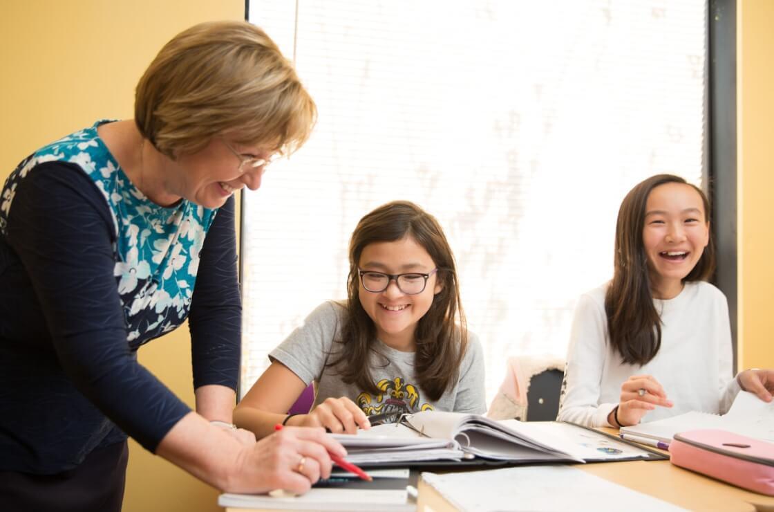 RSM teacher helping a student at her desk
